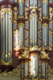 Church Organ. A close up of a church organ with pipes in various sizes, lit by the bright light coming through the church windwos Stock Photos