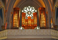 Church organ in front of ornamental window Stock Images