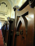 Church organ and pew. S down the aisle royalty free stock photo
