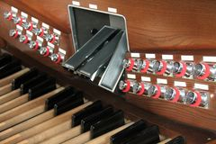 Church Organ. The Stops and Pedals of a Large Church Organ stock image