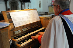 An organist at the keys Royalty Free Stock Photo