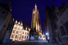 Church of Our Lady Bruges from cobblestone  road Stock Photo