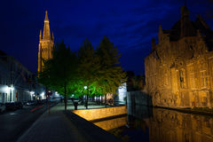 Church of Our Lady Bruges on Groenerei canal. At night, Bruges, Belgium Royalty Free Stock Photo