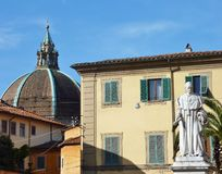 Church of our lady of humility in Pistoia. The dome of the church of our lady of humility in Pistoia in Tuscany in Italy with a statue in front Stock Photography
