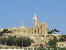 Church. Our Lady of Lourdes church overlooks the ferry terminal on the Maltese island of Gozo Stock Image