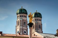 Church of Our Lady and Mary's Column two landmarks of Munich royalty free stock photos