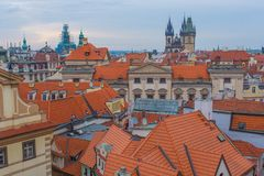 Church of our Lady with orange roofs. View of the Tyn Church in Prague at the morning Royalty Free Stock Photography