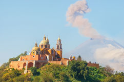 Church of Our Lady of Remedies with Popocatepetl Volcano, Mexico Royalty Free Stock Images