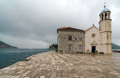 Church of Our Lady on the Rock, Montenegro. Our Lady of the Rocks is one of the two islets off the coast of Perast in Bay of Kotor, Montenegro. It is an Stock Photos