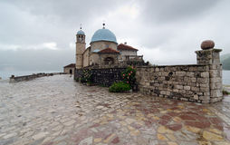 Church of Our Lady on the Rock. Our Lady of the Rocks is one of the two islets off the coast of Perast in Bay of Kotor, Montenegro. It is an artificial island Royalty Free Stock Images