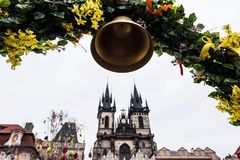 Church of Our Lady before Tyn and flowers arch. Church of Our Lady before Tyn and colorful spring flowers arch. Cloudy and dramatic sky on background. Prague Stock Photos