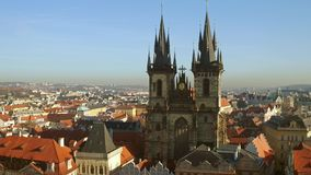 The Church of Our Lady before Tyn and tiled roofs of old town of Prague on a sunny day, Czech Republic. 4K overview pan. Video stock footage