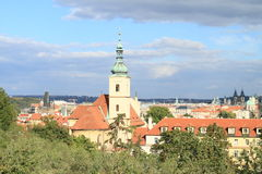 Church of Our Lady Victorious. In Prague (Czech Republic) behind trees Royalty Free Stock Photography