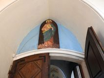 Church with over door painted Jesus Christ, Lithuania stock photo