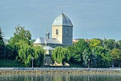 The church over the pond is an ancient in Ternopil. Royalty Free Stock Photos