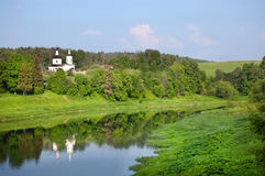 Church over the river. Landscape with the river and white church against summer greens royalty free stock photo