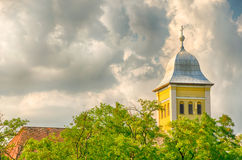 Church over the trees, dramatic cloudy sky Royalty Free Stock Photography