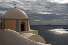 Church Overlooks Santorini Caldera on Rainy Day Royalty Free Stock Image