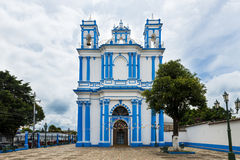 Church painted in blue and white in the city of San Cristobal de Las Casas, Mexico stock photos
