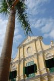 Church and palm tree. Exterior of catholic church with palm tree in foreground Royalty Free Stock Photo