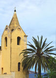 Church & palm tree. Antique church and palm tree on the beach Royalty Free Stock Photo