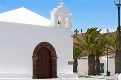 Church and palm tree Stock Photos