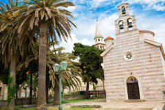 Church and palm trees. Small church in the Budva with palm trees near it Royalty Free Stock Photography