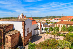 Church and palm trees on square of Silves town Stock Images
