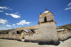 Church in Parinacota, Chile. It was built in the 17th century in the form of a central nave with two side chapels. Walls are made of stone and clay and Royalty Free Stock Photo