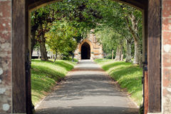 Church Path. Peaceful tree lined pathway through churchyard. Stock Photo