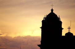 Church- Peru. Bell-tower of the Church of La Compania de Jesus silhouetted at sunset in the colonial city of Cusco (Sacred Valley), Peru Royalty Free Stock Photography