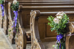 Church pew details with floral wedding  decoration Stock Photos