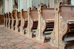Church pews. Wooden pews in row in a catholic church Royalty Free Stock Photos