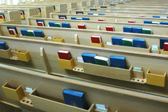 Church Pews. With the holy bibles, and hymnals on the back of each pew stock image