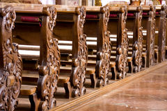 Church Pews. Symmetry of wood carving on church pews royalty free stock photos