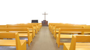Church pews in front of cross and altar. Rows of church pews before an altar and cross in an old Christian church stock photography