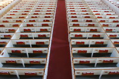 Church Pews - View from Choir Loft. Rows of Church pews in a meticulously ordered with Bibles and Hymnals in the front compartments Royalty Free Stock Photography