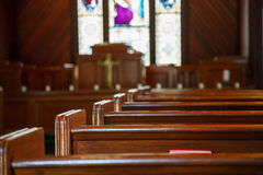 Church Pews With Stained Glass Beyond Pulpit Stock Photos