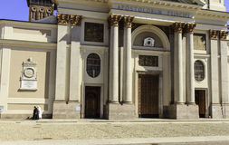 Church in Piemonte, Italy. Front of a church, with walking nuns, at Alessandria, Cuneo, Piemonte, Italy royalty free stock photo