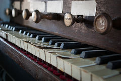 Old church pipe organ. Old pipe organ sits unused in a poor state of repair in St George's Church, Portland Royalty Free Stock Photo