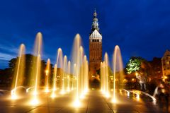 Church in Poland. Tower of Saint Nicholas Cathedral through illumination fountain in Elblag, Poland Stock Images