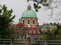Church in Prague Old Town. Large church across the river Vltava Stock Photography