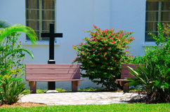 Church prayer garden with benches and cross Stock Photography