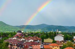 Church and rainbow Stock Photo