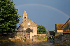 Church with a rainbow of Taize ,Burgundy. Royalty Free Stock Photos