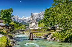 Church of Ramsau, Berchtesgadener Land, Bavaria, Germany. Scenic mountain landscape in the Bavarian Alps with famous Parish Church of St. Sebastian in the Stock Image
