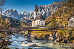 Church of Ramsau in fall, Berchtesgadener Land, Bavaria, Germany. Parish Church of St. Sebastian at sunrise in fall, Ramsau, Nationalpark Berchtesgadener Land Royalty Free Stock Images