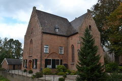 Church with rectory near castle Huis Bergh Royalty Free Stock Photos