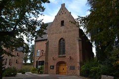 Church with rectory near castle Huis Bergh Royalty Free Stock Photography