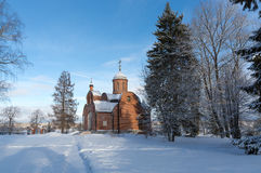 Church of red brick on a sunny day in winter. Winter landscape. Royalty Free Stock Image